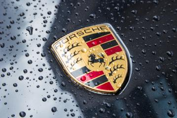LONDON, UNITED KINGDOM MAY, 2017: Porsche Logo Close Up on a black car with rain drops. Ferdinand Porsche founded the company in 1931 with main offices in the centre of Stuttgart. : Stock Photo or Stock Video Download rcfotostock photos, images and assets rcfotostock | RC-Photo-Stock.: