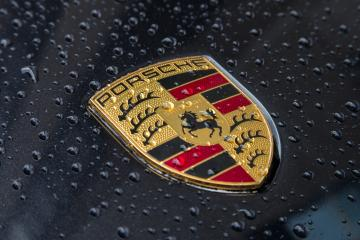 LONDON, UNITED KINGDOM MAY, 2017: Porsche Logo Close Up on a black car with rain drops. Ferdinand Porsche founded the company in 1931 with main offices in the centre of Stuttgart.- Stock Photo or Stock Video of rcfotostock | RC-Photo-Stock