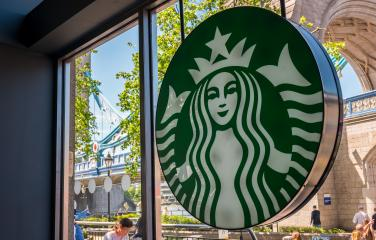 LONDON, UNITED KINGDOM MAY, 2017: Starbucks logo in a store. Starbucks is the largest coffeehouse company in the world.- Stock Photo or Stock Video of rcfotostock | RC-Photo-Stock