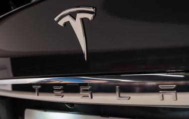 LONDON, UNITED KINGDOM MAY, 2017: Tesla Logo on a black car. Tesla Motors, Inc. is an American automotive and energy storage company.- Stock Photo or Stock Video of rcfotostock | RC-Photo-Stock