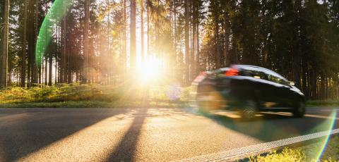 Long Forest Road with car In Alpine Mountains at sunset- Stock Photo or Stock Video of rcfotostock | RC-Photo-Stock
