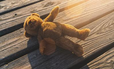 Lost teddy bear lying on a boardwalk- Stock Photo or Stock Video of rcfotostock | RC-Photo-Stock
