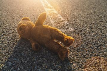 Lost teddy bear lying on the street : Stock Photo or Stock Video Download rcfotostock photos, images and assets rcfotostock | RC-Photo-Stock.: