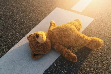 Lost teddy bear lying on the street after an accident : Stock Photo or Stock Video Download rcfotostock photos, images and assets rcfotostock | RC-Photo-Stock.: