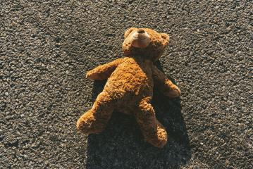 Lost teddy bear lying on the street after an accident, with skidmarks - Stock Photo or Stock Video of rcfotostock | RC-Photo-Stock