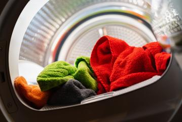 lots of colorful clean fresh hand towels in a washing machine or dryer : Stock Photo or Stock Video Download rcfotostock photos, images and assets rcfotostock | RC-Photo-Stock.: