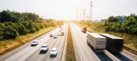 Lots of Trucks and cars on a Highway - transportation concept- Stock Photo or Stock Video of rcfotostock | RC-Photo-Stock