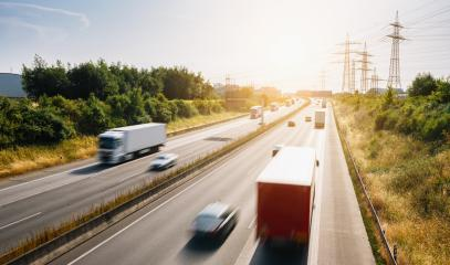 Lots of Trucks and cars on a Highway - transportation concept- Stock Photo or Stock Video of rcfotostock   RC-Photo-Stock