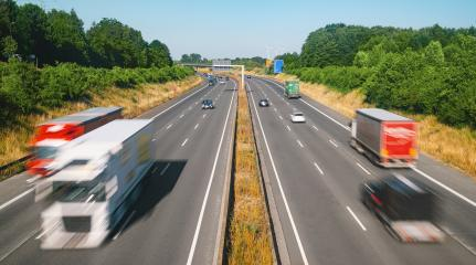 Lots of Trucks and cars on a Highway - transportation concept : Stock Photo or Stock Video Download rcfotostock photos, images and assets rcfotostock | RC-Photo-Stock.: