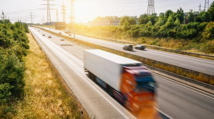 Lots of Trucks and cars on a Highway - transportation concept, copyspace for your individual text.- Stock Photo or Stock Video of rcfotostock | RC-Photo-Stock