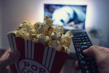 Male hand holding TV remote control and popcorn box, Point of view shot- Stock Photo or Stock Video of rcfotostock | RC-Photo-Stock