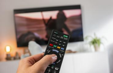Male hand holding TV remote control and Watch tv- Stock Photo or Stock Video of rcfotostock | RC-Photo-Stock