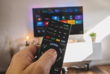 Male hand holding TV remote control, Point of view shot- Stock Photo or Stock Video of rcfotostock | RC-Photo-Stock