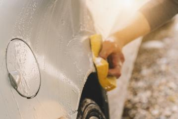 Male hand with yellow sponge washing car- Stock Photo or Stock Video of rcfotostock | RC-Photo-Stock