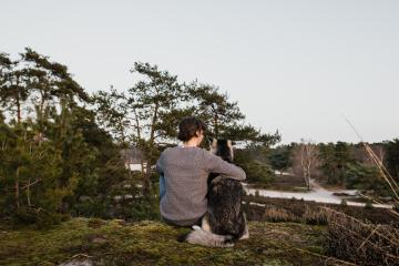 Man and dog from behind. The woman hugs the husky. You have a great view of beautiful, relaxing nature. You enjoy freedom. : Stock Photo or Stock Video Download rcfotostock photos, images and assets rcfotostock | RC-Photo-Stock.: