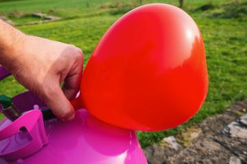 man filling Heart shape balloon with helium gas- Stock Photo or Stock Video of rcfotostock | RC-Photo-Stock