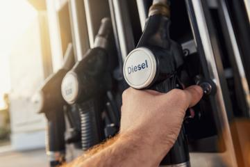 Man hand holding gas pump nozzle- Stock Photo or Stock Video of rcfotostock | RC-Photo-Stock