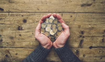 man hands holding a heap of euro coins banner background, top view, with copy space- Stock Photo or Stock Video of rcfotostock | RC-Photo-Stock