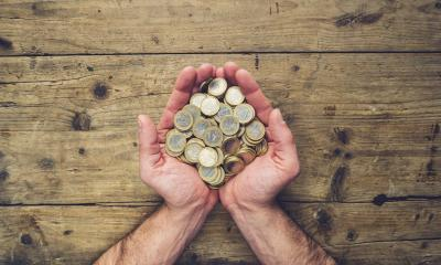 man hands holding a stack of euro coins, top view, with copy space- Stock Photo or Stock Video of rcfotostock | RC-Photo-Stock