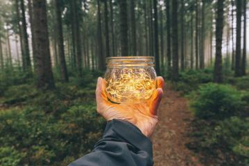 man hold a Transparent jar with lights from led in a misty forest. Romantic Hipster Concept image- Stock Photo or Stock Video of rcfotostock | RC-Photo-Stock