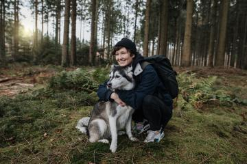 Man hugs his cute white-black husky dog friend in the forest with sunset. Outdoor autumn mood. Enjoy nature life and lovely friendship with with a pet.  : Stock Photo or Stock Video Download rcfotostock photos, images and assets rcfotostock | RC-Photo-Stock.: