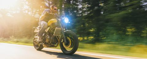 man on a motorbike on the road riding. having fun driving the empty road on a motorcycle tour journey. copyspace for your individual text.- Stock Photo or Stock Video of rcfotostock | RC-Photo-Stock