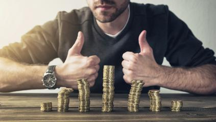 man shows thumb up with coins stack on wood table, Concept business finance or investment- Stock Photo or Stock Video of rcfotostock | RC-Photo-Stock