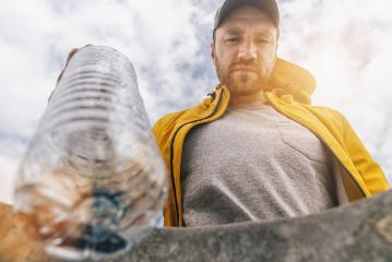 man throw plastic bottle in to garbage- Stock Photo or Stock Video of rcfotostock | RC-Photo-Stock