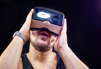 Man uses Virtual Realitiy VR head-mounted display- Stock Photo or Stock Video of rcfotostock | RC-Photo-Stock