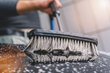 man using a brush to wash a car - Stock Photo or Stock Video of rcfotostock | RC-Photo-Stock