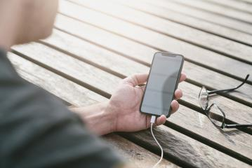 man using a smart phone in his outdoor office- Stock Photo or Stock Video of rcfotostock | RC-Photo-Stock
