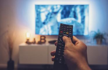 man Watching movie and using remote control- Stock Photo or Stock Video of rcfotostock | RC-Photo-Stock