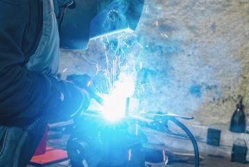 man welds at the factory- Stock Photo or Stock Video of rcfotostock | RC-Photo-Stock