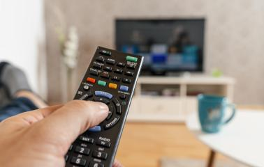 man with the remote control in hand watching the smart tv and presses the button on the remote control. Remote control in hand closeup. : Stock Photo or Stock Video Download rcfotostock photos, images and assets rcfotostock | RC-Photo-Stock.: