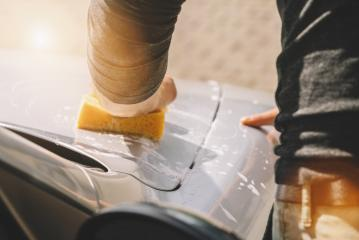 Man worker hold sponge for washing car- Stock Photo or Stock Video of rcfotostock | RC-Photo-Stock