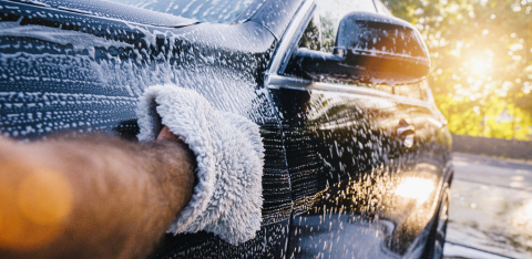 Man worker washing black SUV with sponge on a car wash. : Stock Photo or Stock Video Download rcfotostock photos, images and assets rcfotostock | RC-Photo-Stock.: