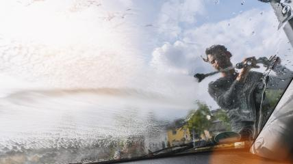 Man worker washing car by pressurized water and foam. copyspace for your individual text.- Stock Photo or Stock Video of rcfotostock | RC-Photo-Stock