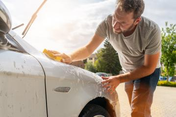 Man worker washing car with sponge- Stock Photo or Stock Video of rcfotostock | RC-Photo-Stock
