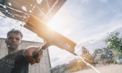 Man worker washing car with squeegee. car wash concept image. copyspace for your individual text.- Stock Photo or Stock Video of rcfotostock | RC-Photo-Stock