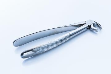 Mandibular wisdom tooth forceps for dentist visiting- Stock Photo or Stock Video of rcfotostock | RC-Photo-Stock