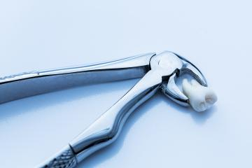 Mandibular wisdom tooth forceps from dentist- Stock Photo or Stock Video of rcfotostock | RC-Photo-Stock