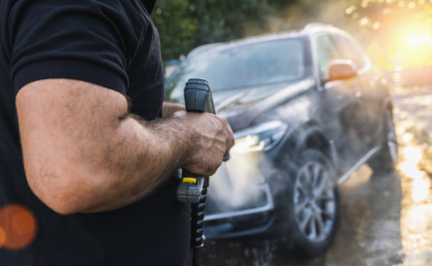 Manual car wash with pressurized water in car wash outside on a SUV : Stock Photo or Stock Video Download rcfotostock photos, images and assets rcfotostock | RC-Photo-Stock.:
