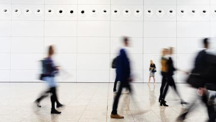 Many anonymous blurred business people traveling in the airport or at a trade fair- Stock Photo or Stock Video of rcfotostock | RC-Photo-Stock