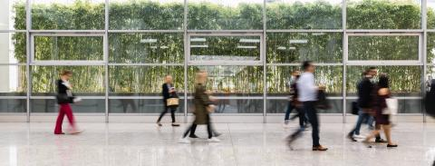 Many anonymous business people are walking through a bright corridor in the modern office- Stock Photo or Stock Video of rcfotostock | RC-Photo-Stock