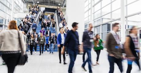Many anonymous business people on the escalator at a business trade fair- Stock Photo or Stock Video of rcfotostock | RC-Photo-Stock