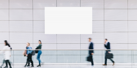 Many anonymous people are walking around advertising posters at a trade fair - Stock Photo or Stock Video of rcfotostock | RC-Photo-Stock