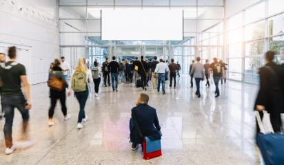 Many anonymous people under blank white advertising poster on a trade fair- Stock Photo or Stock Video of rcfotostock | RC-Photo-Stock