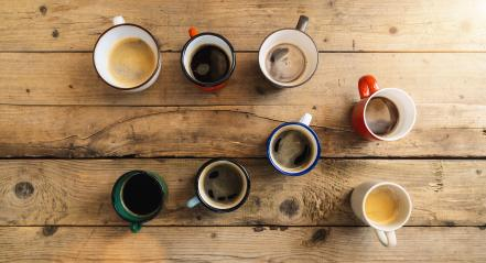 Many Coffee Cups or mugs on a wooden table, top view- Stock Photo or Stock Video of rcfotostock | RC-Photo-Stock
