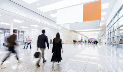 Many trade fair visitors run under advertising poster - Stock Photo or Stock Video of rcfotostock | RC-Photo-Stock