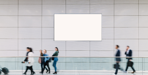 Many trade fair visitors walk under a blank billboard through a hall, copyspace for your individual text.- Stock Photo or Stock Video of rcfotostock | RC-Photo-Stock